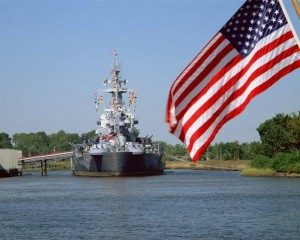 Battleship_and_flag_on_river-web
